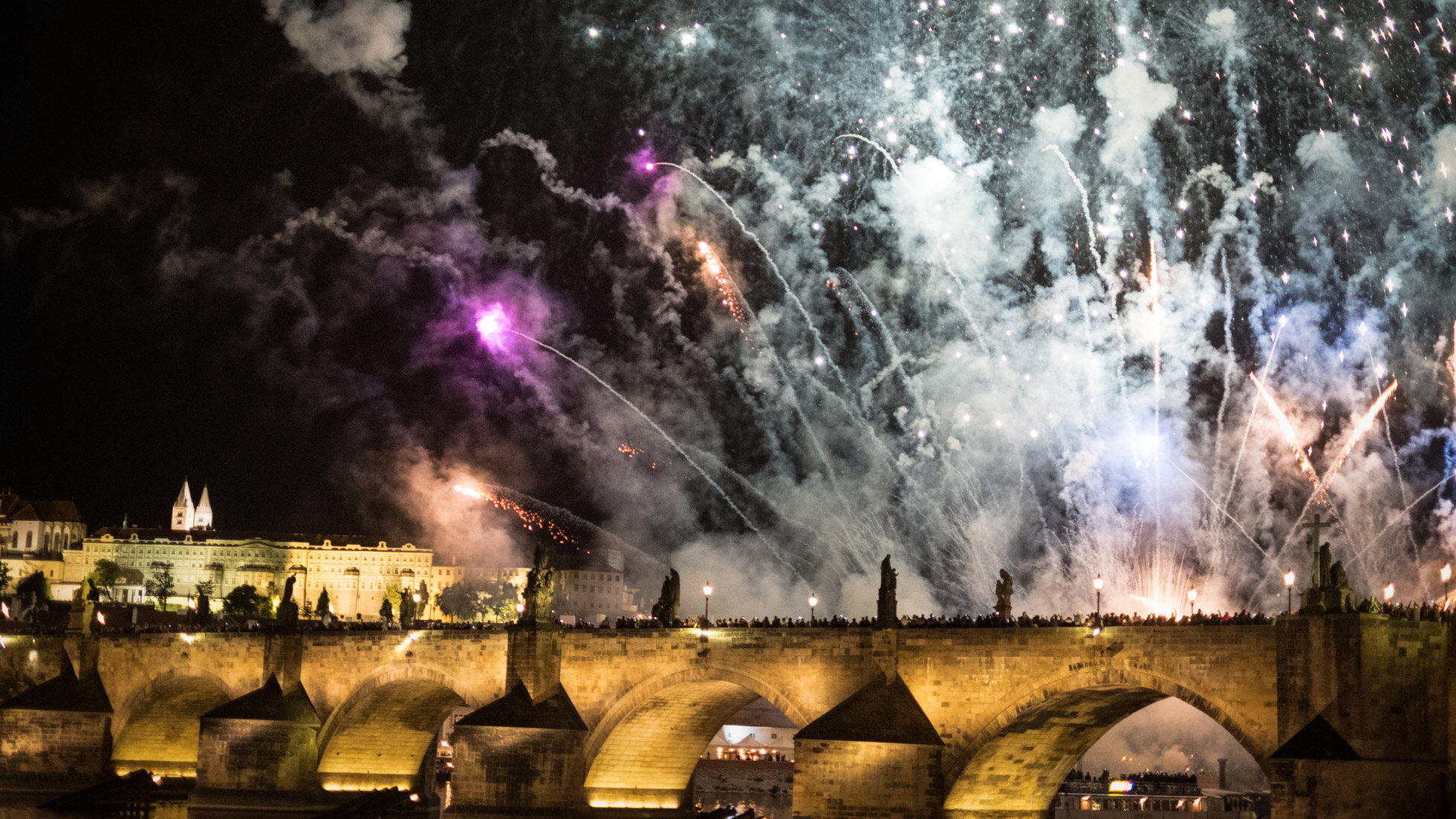 New Year Fireworks over Charles Bridge in Prague with Prague Castle in the background
